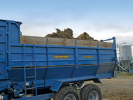 Round bales loaded into wagon ready to be fed out